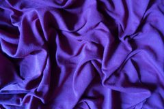 Violet cotton fabric in soft folds. Violet cotton jersey fabric in soft folds Stock Photography