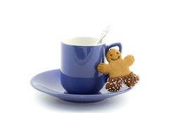 Violet cup and saucer with gingerbread man cookie Stock Photography
