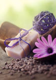 Violet dayspa nature set. Spa and wellness setting with natural soap, candles and towel. Violet dayspa nature set dayspa nature set Stock Images
