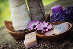 Violet dayspa nature set. Spa and wellness setting with natural soap, candles and towel. Violet dayspa nature set dayspa nature set Stock Photography