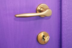 Violet Door. Violet closed door with gold key Royalty Free Stock Photo