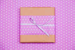 Violet dotted gift box Stock Photos