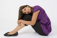 Violet Dress. Latino model in violet dress and black pants - studio on white background Royalty Free Stock Image