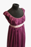 Violet dress on tailor's dummy Royalty Free Stock Photo