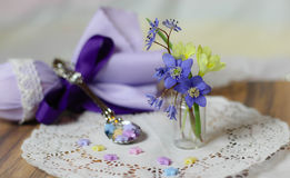 Violet easter collage spring flowers stars spoon teatime Royalty Free Stock Images