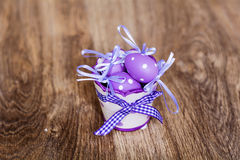 Violet easter eggs on a wooden background Royalty Free Stock Images