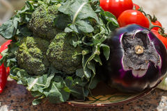 Violet eggplant ball with broccoli and red tomatoes, fresh healt Royalty Free Stock Image