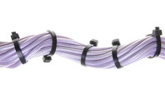 Violet electrical cables with cable ties Royalty Free Stock Photos