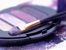 Violet eye shadows. Make-up eye shadows and cosmetic brush Royalty Free Stock Photos