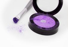 Violet eyeshadow with brush. Applicator  on white Stock Photo