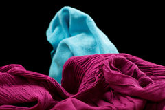 Violet fabric on a black Stock Photography