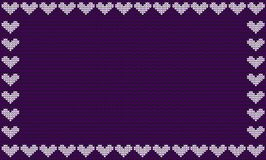 Violet fabric knitted background framed with knit hearts. Stock Photo