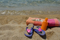 Violet flip flops and beach set royalty free stock image