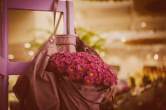 Violet flowers in bag Royalty Free Stock Photo