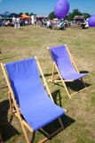 Violet folding chairs at the fair stock photo