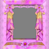 Violet frame with florets. Laces, and  a curtain for photo registration Stock Photography