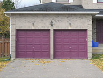 Violet garage doors. Attached garage with double doors Royalty Free Stock Photos