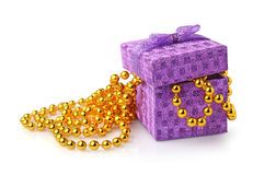 Violet gift box and golden beads Stock Photo