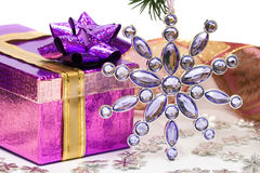 Violet gift with Christmas star Stock Images