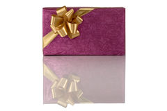 Violet gift with gold bow Stock Images
