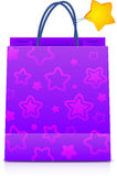 Violet gift paper bag with stars pattern Stock Photo