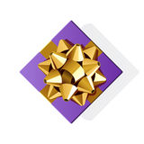 Violet gift top view with gold bow Stock Images