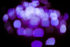 Violet glitter lights background. defocused stock image