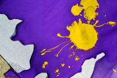 Violet gouache paint and a yellow blotch in the middle. Close-up. Abstract background purple and yellow liquid paint. Artistry, art, creativity Stock Images