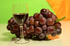 Violet grape and a glass of vine Royalty Free Stock Photo