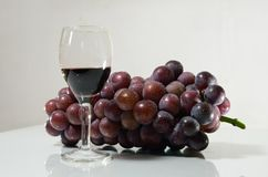 Violet grape and glasses of vine Stock Image
