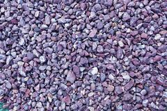 Violet gravel stone floor texture background.  royalty free stock image