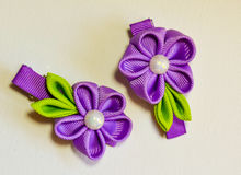 Violet and green hair bows stock photos