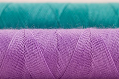 Violet and green thread Stock Photo