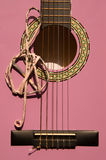 Violet guitar for children with treble clef closeup. For music school Stock Image