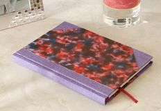 Violet  handmade notebook. Royalty Free Stock Photo