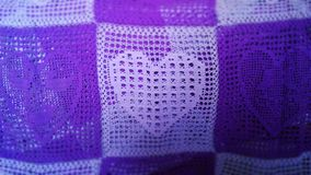Violet hearts crocheted bedspread Stock Images