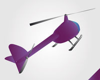 Violet helicopter toy at flight  Royalty Free Stock Images