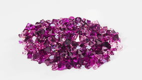 Violet jewel stones heap turning over white, loop ready stock video footage