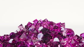 Violet jewel stones heap turning over white, loop ready stock video