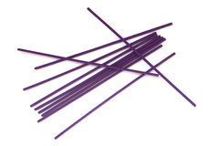 Violet joss sticks. Isolated on a white background Stock Photos