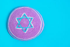 Violet kipa on a blue background, top view. Jewish New Year, Rosh Hashanah Stock Image