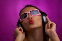 Violet kiss. Glamour portrait of young brunette in pink sunglasses giving a kiss Stock Photos
