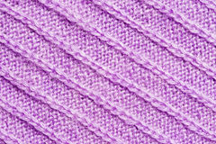 Violet knitted background Stock Images