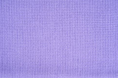 Violet knitted fabric Stock Images