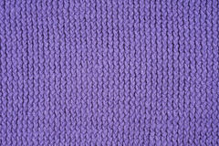 Violet knitted pattern. As a seamless background Stock Photography