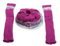 Violet knitted winter hat and sleeve covers Royalty Free Stock Image