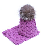 Violet knitted woolen scarf and hat with pompom isolated on white background. Stock Photo
