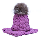 Violet knitted woolen scarf and hat with pompom isolated on white background. Royalty Free Stock Images