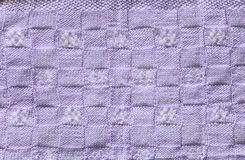 Violet Knitted Fabric Texture. Violet knitting or knitted fabric texture pattern background. Knitting or knitted. Violet knitting background. knitting pattern Stock Photos
