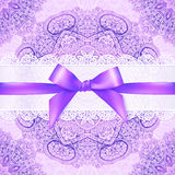 Violet lacy greeting card cover with purple ribbon Royalty Free Stock Photo